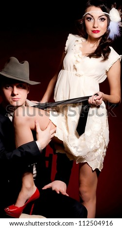 Fashion beautiful photo of man and woman in style Chicago gangster