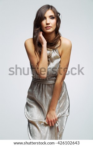 Fashion beautiful woman portrait. Female young model. Isolated , gray background . Fashion model studio poses.
