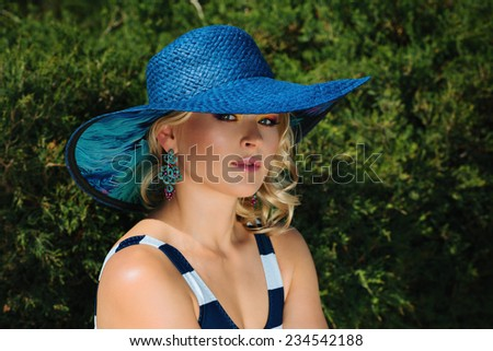 Fashion beautiful woman sunbathing. Vogue style - stock photo
