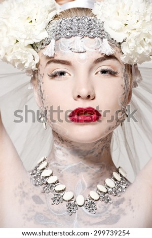 Fashion beautiful woman with flower  and veil. Tribal dancer. Tribal bride.