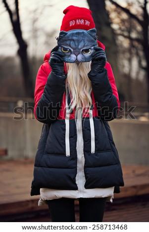Fashion beautiful woman with mask outdoors - stock photo