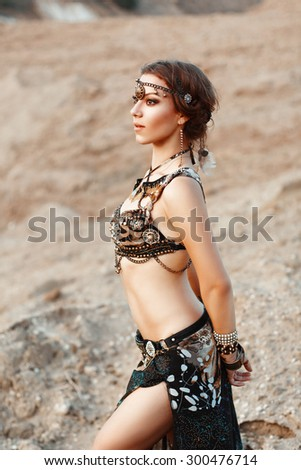 Fashion Beauty and stylish girls. Spirituality dance. Beautiful Sexy Woman With Luxury glossy gold eastern Makeup danceing tribal fusion. Indian accessories (oriental jewelry) - stock photo