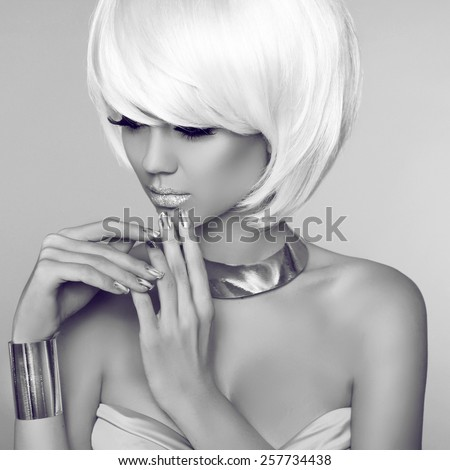 Fashion Beauty Blond Girl Portrait with White Short Hair. Face Close-up. Haircut. Hairstyle. Fringe. Make-up. Isolated on grey Background. Vogue Style Woman. - stock photo