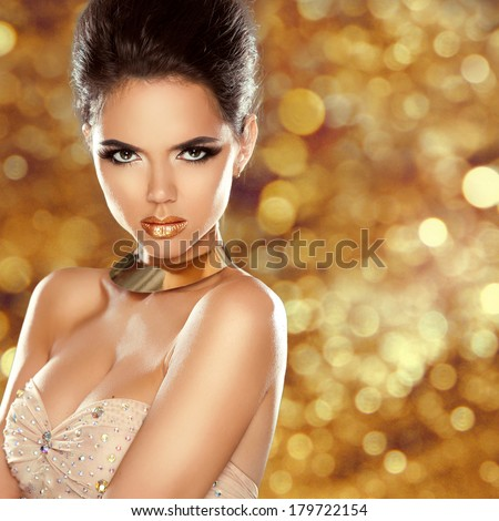 Fashion Beauty Girl Portrait Isolated on golden Christmas glittering lights Background. Glamour Makeup. Gold Jewelry. Hairstyle - stock photo