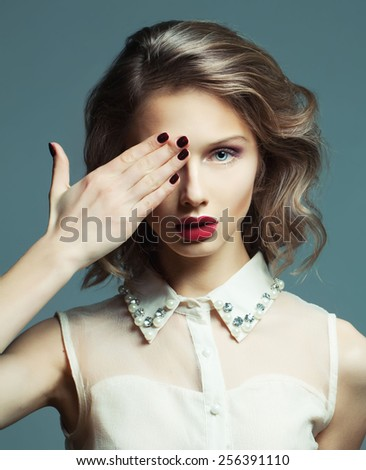 Fashion Beauty Girl Portrait over grey background. Glamour Makeup and nails.  Hairstyle. - stock photo