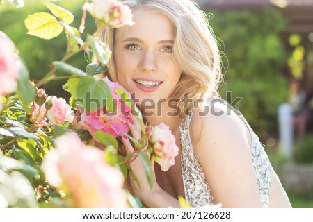 Fashion beauty girl with roses flowers - stock photo