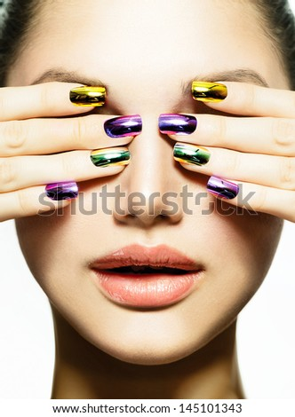 Fashion Beauty. Manicure and Make-up. Nail art. Beautiful Woman With Colorful Nails and Luxury Makeup. Beautiful Girl Face and Hand