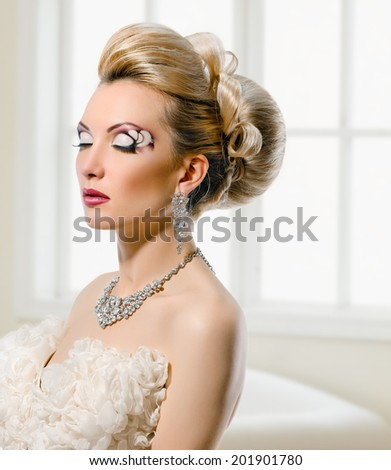 Fashion Beauty Model. Bride. Creative Make up and Hair Style. On window background