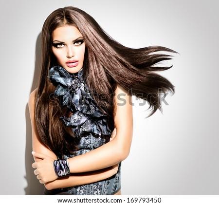 Fashion, Beauty Model Brunette Girl with long Straight Blowing Hair. Beauty Fashion Model Girl Portrait. Vogue Style Woman. Beautiful Makeup. Trendy Wear  - stock photo