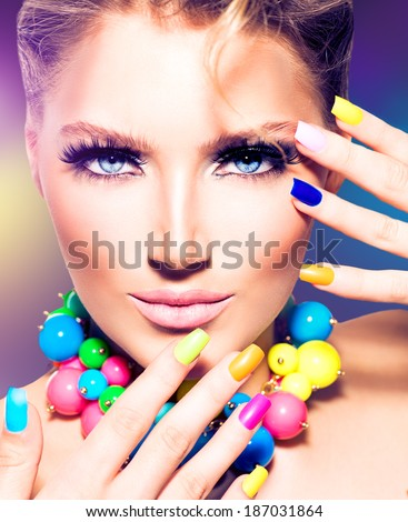 Fashion Beauty model girl with colorful Nails. Vivid rainbow manicure and accessories. Beautiful woman portrait with perfect makeup - stock photo