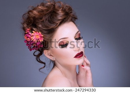 Fashion Beauty Model Girl with Flowers Hair. Bride. Perfect Creative Make up and Hair Style. Hairstyle. Bouquet of Beautiful Flower - stock photo