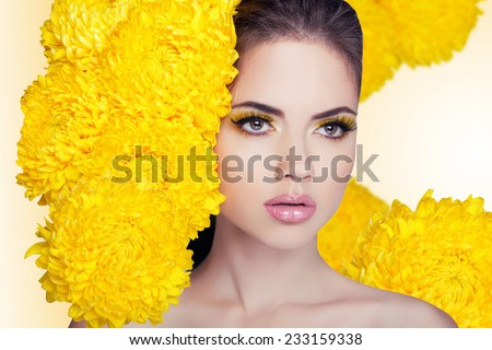Fashion Beauty Model Girl with Flowers Hair.  Makeup and Hair Style. Hairstyle. Bouquet of Beautiful Flowers. - stock photo