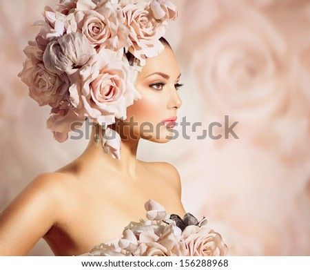 Fashion Beauty Model Girl with Flowers in her Hair. Bride. Perfect Creative Make up and Hair Style. Bouquet of Beautiful Flowers. Floral Hairstyle - stock photo