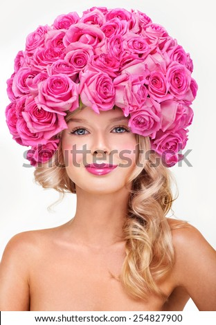 Fashion Beauty Model Girl with Pink Roses. Bouquet of Beautiful Flowers.  Perfect skin Hat with roses. - stock photo