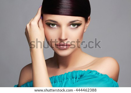 Fashion Beauty Portrait.healthy Hair. Beautiful Girl in blue dress.Fringe Hairstyle.Professional Makeup. young Woman - stock photo