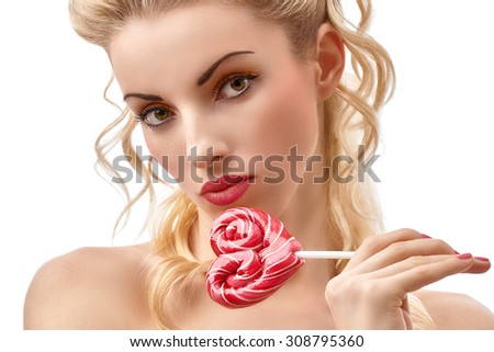 Fashion beauty portrait of nude sexy girl with heart lollipop. Provocative people. Sensual attractive playful blond woman. Brown-eyed girl with luxury makeup, red lips. Face closeup. Isolated on white - stock photo