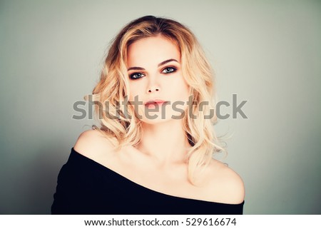 Fashion Beauty Portrait of Pretty Woman Model witn Blonde Hair and Makeup