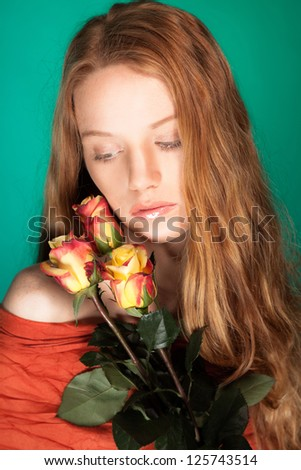 Fashion beauty portrait of woman with flowers and red hair.