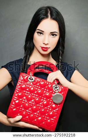 Fashion Beauty Portrait of Woman with Red Handbag - stock photo