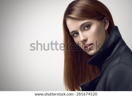 Fashion beauty portrait of young sexy red-haired model with long straight hair. Professional makeup. - stock photo