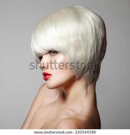 Fashion Beauty Portrait. White Short Hair. Haircut. Hairstyle. Fringe. Makeup. Vogue Style Woman. Gray Background. - stock photo