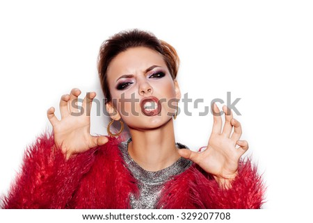 Fashion Beauty Swag Angry Girl  showing cat. Gorgeous Woman Portrait. Stylish Haircut and Makeup. Vogue Style. Close-up of Sexy Glamour Girl on White background no isolated - stock photo