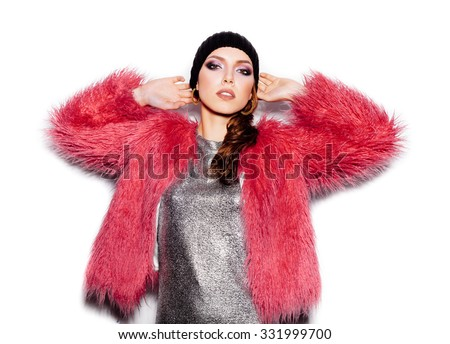 Fashion Beauty Swag Girl wearing silver dress, pink fur coat, black beanie hat. Gorgeous young Woman Portrait. Stylish Haircut and Makeup. Vogue Style on white background no isolated - stock photo