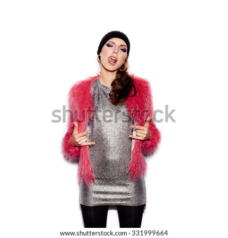 Fashion Beauty Swag Girl wearing silver dress, pink fur coat, black beanie hat. Stylish Haircut and Makeup. Gorgeous young Woman posing on white background no isolated - stock photo