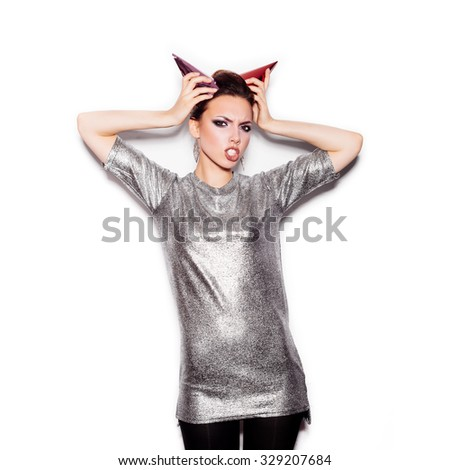 Fashion Beauty Swag Girl with Horns. Gorgeous Woman Portrait. Stylish Haircut and Makeup. Vogue Style. Close-up of Sexy Glamour Girl on White background no isolated - stock photo