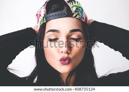 Fashion Beauty Swag Teen Girl. Gorgeous Woman Portrait. Trendy hat and Makeup. Vogue Style. Close-up of Sexy Glamour Girl on White background no isolated.Urban Style.Toned - stock photo