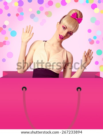 Fashion beauty woman in huge shopping bag surprised looks out of it on colored background with copy space. Pinup funny blonde girl, hairstyle with fringe and pink bow, shopaholic. Vintage style - stock photo