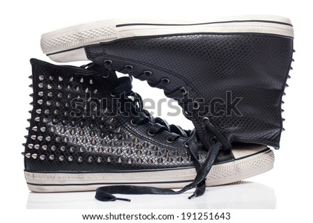 Fashion. Black gumshoes on the white background