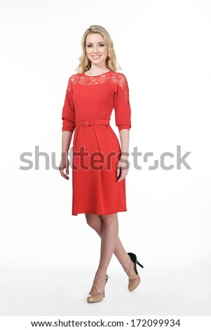 fashion blond business woman portrait in red office dress
