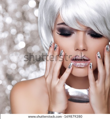 Fashion Blond Girl. Beauty Portrait Woman. White Short Hair. Isolated on blinking Christmas Background. Face Close-up. Manicured nails. Vogue Style. - stock photo