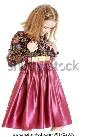 Fashion blond girl in a satin long dress. The girl examines your outfit, close-up-Isolated on white background - stock photo