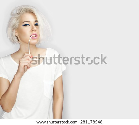 Fashion blond model with sunglasses in hand on a white background - stock photo
