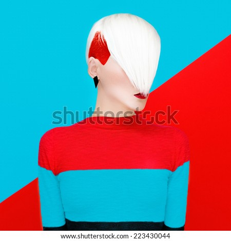 Fashion Blond Model with trendy Hairstyle on a colorful background. Art photo - stock photo