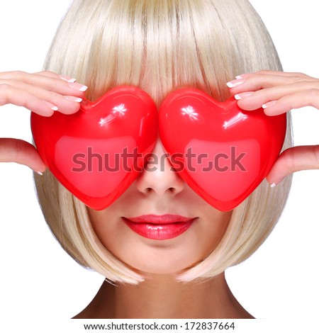 Fashion Blonde Girl with Red Hearts in Valentines Day. Glamorous Young Woman with Short Bob Hairstyle isolated on white. Love Concept.  - stock photo