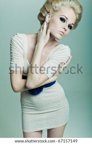 Fashion blonde hugging himself - stock photo