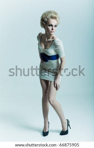 Fashion blonde in a dress with a belt and shoes - stock photo