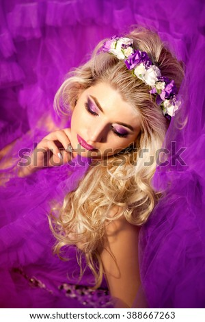 Fashion Blonde Model Portrait. Hairstyle. Haircut. Professional Makeup. False Eyelashes. Purple Make-up
