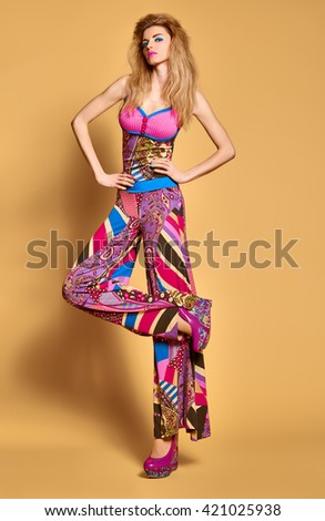 Fashion blonde woman in colorful luxury summer dress, glamor shoes with volume hairstyle, make up. Beauty sexy model in stylish bright clothes. Expressive playful vivid girl. Unusual creative lady.  - stock photo