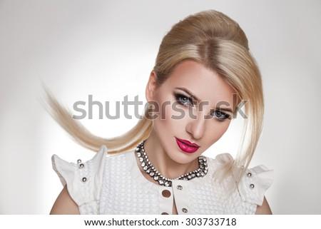 Fashion Blonde Woman Portrait. Blond Hair. Hairstyle. Haircut. Studio shot. horizontal. gray background. - stock photo