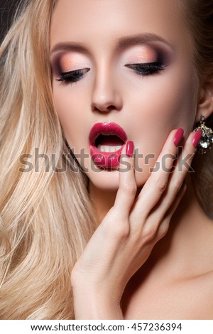 Fashion blonde woman with beautiful face - isolated on blue. Skin care concept