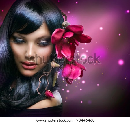 Fashion Brunette Girl with Magnolia Flowers