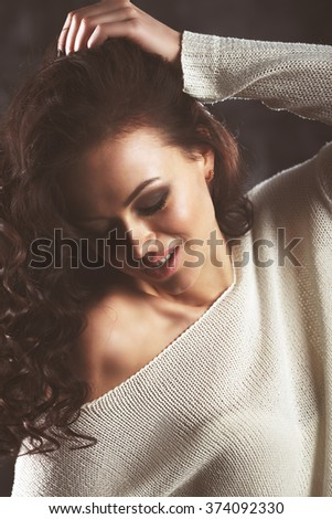 fashion brunette girl with white sweater. Vogue style vintage color effect. Curly hairstyle. Glamour trend photoshoot - stock photo