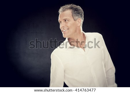 Fashion businessman with white shirt isolated on black