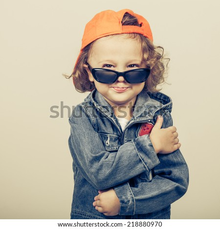 Fashion child. Happy boy model. Stylish little boy in baseball.  Handsome  kid  in the jeans jacket. - stock photo