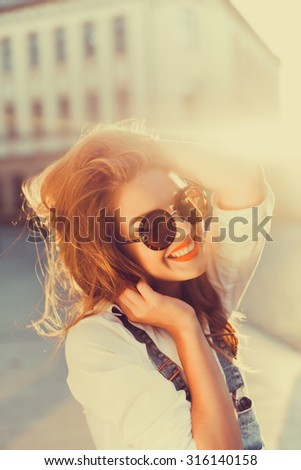 Fashion city portrait of stylish hipster woman, natural nude dress makeup, long brunette hairs, walking alone at weekend, enjoy vacation in Europe, vintage trendy summer outfit, evening soft sunlight  - stock photo