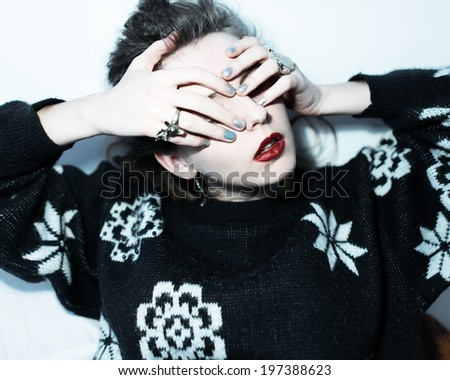 Fashion close-up portrait of a girl with dreadlocks